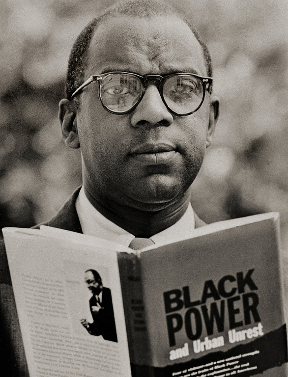 ". The Rev. Dr. Nathan Wright Jr. is shown with his book ""Black Power and Urban Unrest\"" in Orange, N.J., August 4, 1967. Dr. Wright, who is executive director of the department of urban work of the Episcopal Diocese of Newark, says the African American may have his Irish up but he took the cue from white men\'s ancestors. He contends that white minorities used \""group power for self directed efforts at self sufficiency and self respect.\"" (AP Photo)"