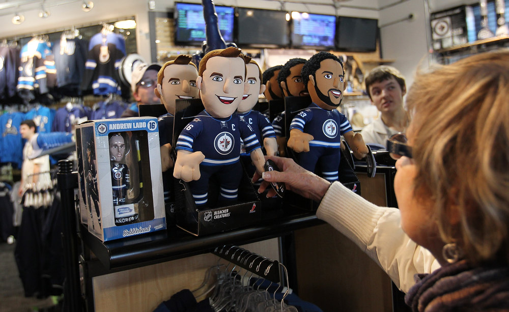 . WINNIPEG, MB - JANUARY 19:  Fans check out the Winnipeg Jets store before the Winnipeg Jets and Ottawa Senators game on January 19, 2013 at the MTS Centre in Winnipeg, Manitoba, Canada. (Photo by Marianne Helm/Getty Images)