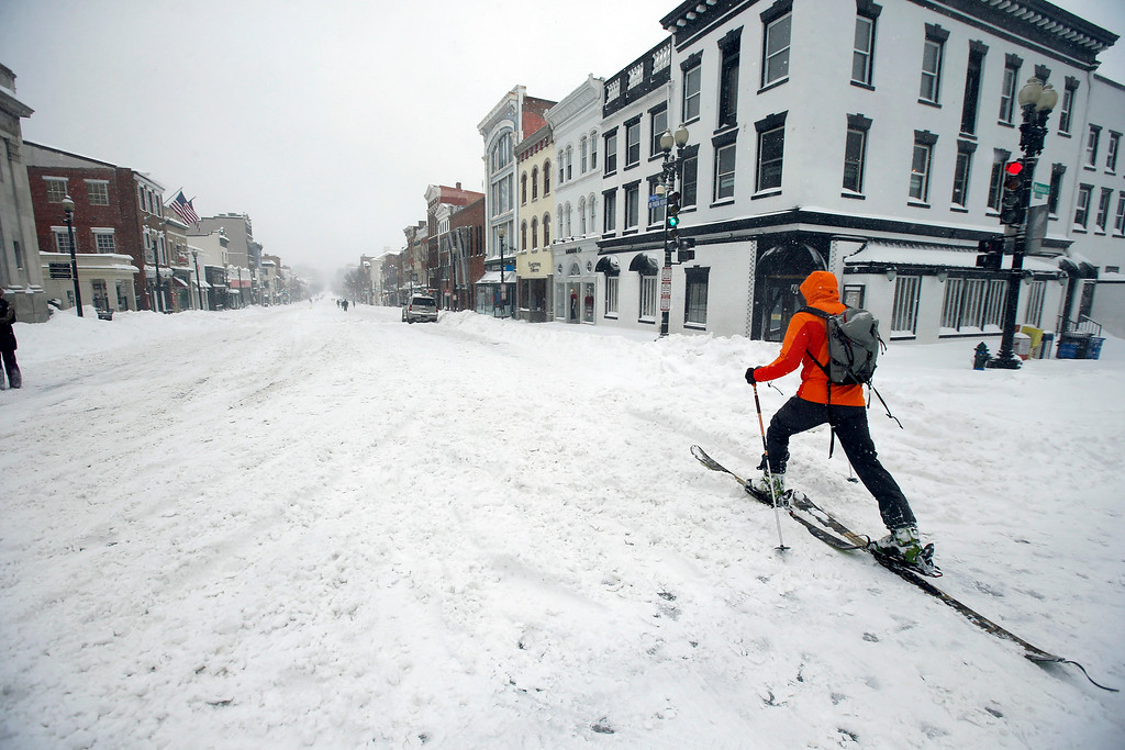 . A man uses cross country skies as he goes down M Street NW in the snow, Saturday, Jan. 23, 2016 in the Georgetown area of Washington. A blizzard with hurricane-force winds brought much of the East Coast to a standstill Saturday, dumping as much as 3 feet of snow, stranding tens of thousands of travelers and shutting down the nation\'s capital and its largest city. (AP Photo/Alex Brandon)