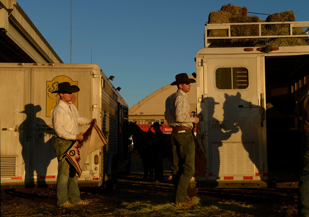 . DENVER, CO- JANUARY 27:   Logan Olson, of Stephenville, Texas, right, who participated in the team roping event at the PRCA rodeo gets his trailer packed up and ready to take off at the end of the last day of the stock show.  The final day of the 2013 National Western Stock show was Sunday, January 27th.  One of the big events for the day was the PRCA Pro Rodeo finals in the Coliseum.  The event featured bareback riding, steer wrestling, team roping, saddle bronc riding, tie down roping, barrel racing and bull riding.  (Photo By Helen H. Richardson/ The Denver Post)