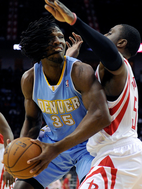 . Denver Nuggets\' Kenneth Faried (35) tries to get past Houston Rockets\' Patrick Patterson (54) in the first half of an NBA basketball game Wednesday, Jan. 23, 2013, in Houston. (AP Photo/Pat Sullivan)