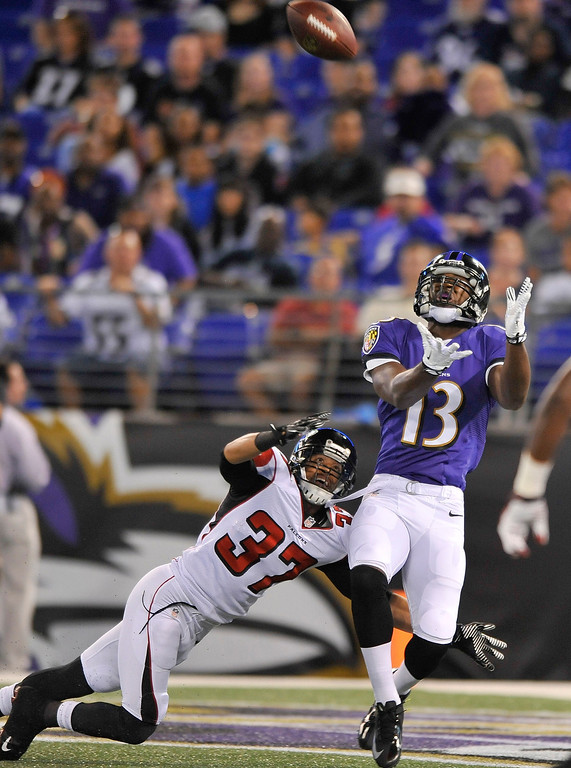 . Baltimore Ravens wide receiver Aaron Mellette pulls in a touchdown pass under pressure from Atlanta Falcons cornerback Peyton Thompson during the second half of a preseason NFL football game in Baltimore, Thursday Aug. 15, 2013. (AP Photo/Gail Burton)