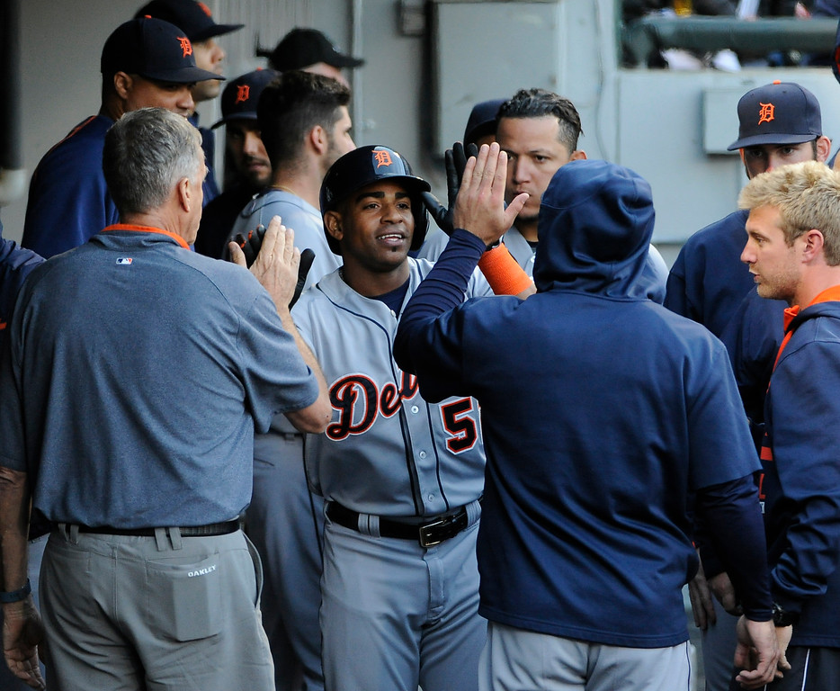 . Detroit Tigers\' Yoenis Cespedes, center, is greeted by teammates after scoring against the Chicago White Sox on a James McCann double during the fifth inning of a baseball game, Saturday, June 6, 2015, in Chicago. (AP Photo/David Banks)