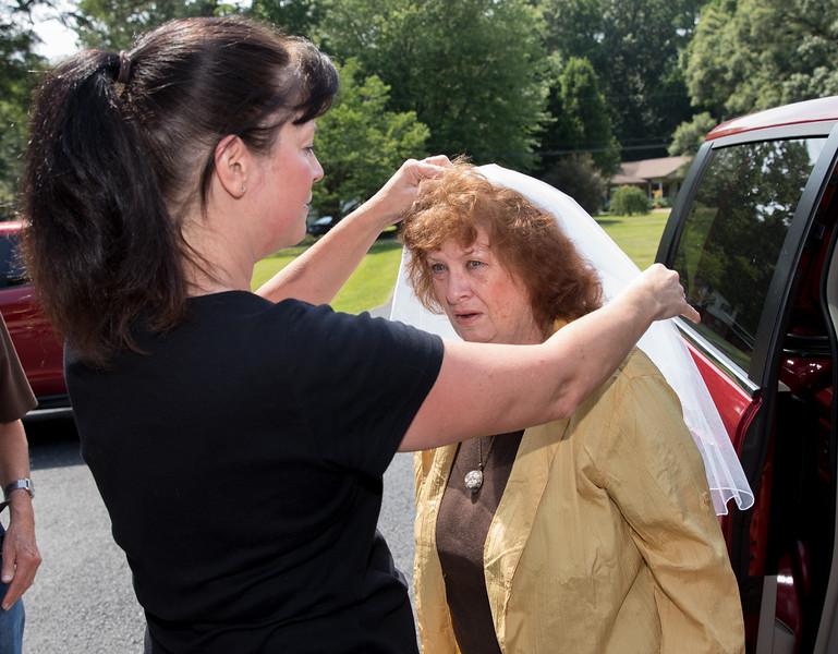 Mom putting veil on Mam.jpg