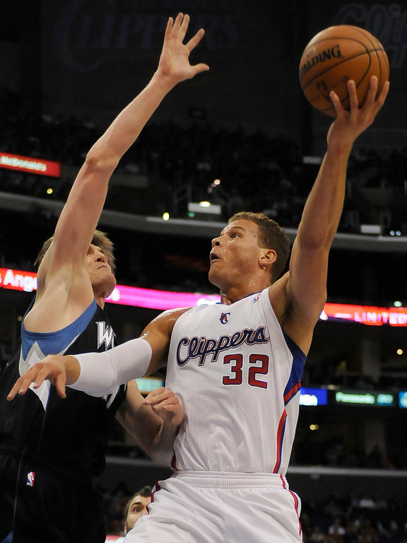 . Timberwolves#47 Andrei Kirilenko gets in front of Clippers#32 Blake Griffin in the first half. The Clippers played the Minnesota Timberwolves in a game played at Staples Center in Los Angeles, CA 4/10/2013(John McCoy/Staff Photographer