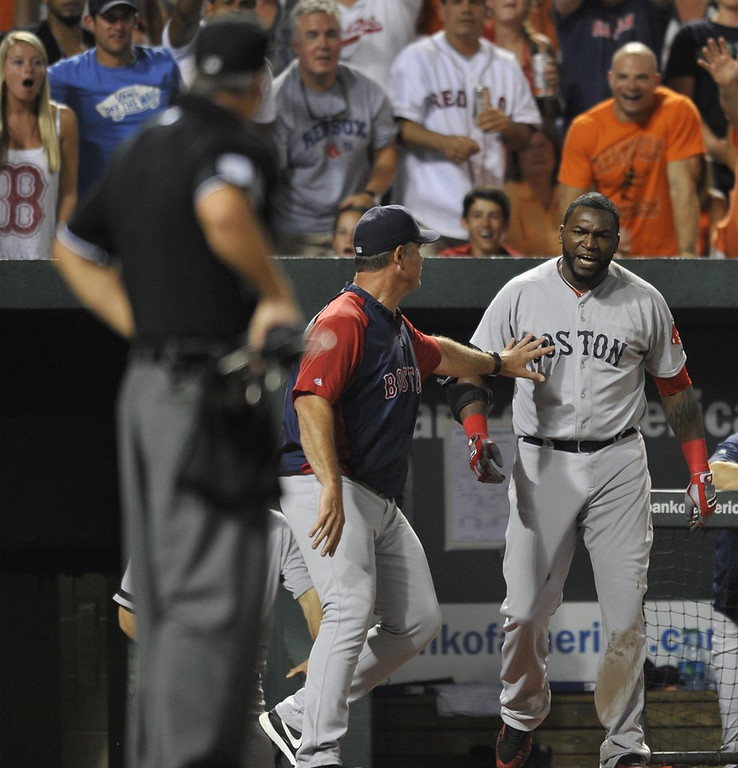 """. <p><b><a href=\'http://ftw.usatoday.com/2013/07/david-ortiz-obliterated-a-dugout-phone-with-his-bat/\' target=\""""_blank\""""> 7. David Ortiz </a></b> <p>�Can you hear me now?� Big Papi asks the umpire after demolishing dugout phone. (unranked) <p> --------------------------------------------  (AP Photo/Gail Burton)"""