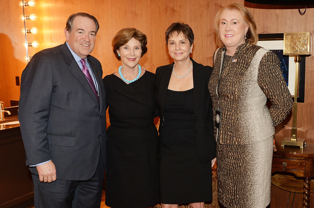 . (L-R) Mike Huckabee, Laura Bush, Nancy Jones, and Janet Huckabee attend the funeral service for George Jones at The Grand Ole Opry on May 2, 2013 in Nashville, Tennessee.  (Photo by Rick Diamond/Getty Images for GJ Memorial)