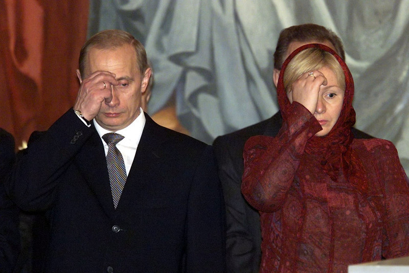 . Russian President Vladimir Putin (L) and his wife Lyudmila cross themselves during Easter service at Christ the Savior Cathedral in Moscow in this April 15, 2001 file photo. Putin and his wife, Lyudmila, said on state television on Thursday that they had separated and their marriage was over after 30 years. REUTERS/Stringer/Files