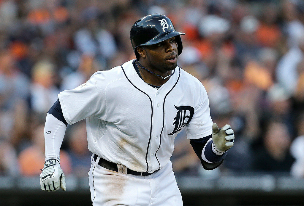 . Detroit Tigers\' Rajai Davis hits a one-run single against the Los Angeles Dodgers in the third inning of a baseball game in Detroit, Tuesday, July 8, 2014. (AP Photo/Paul Sancya)