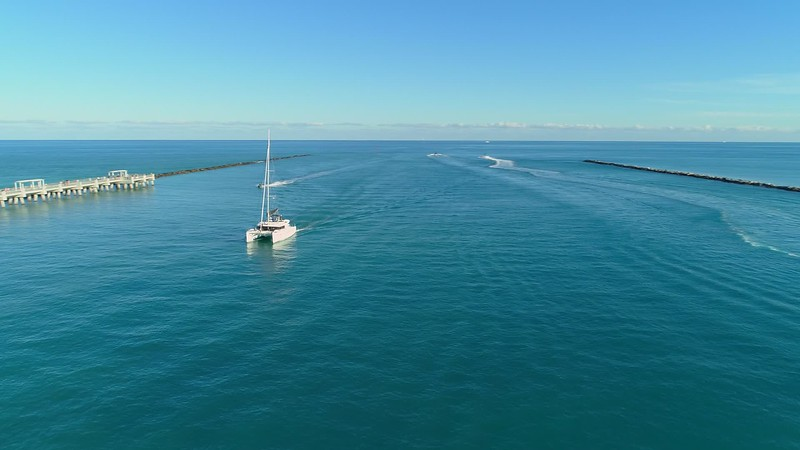 Aerial drone video sail boat and waverunner Government Cut Miami Beach 4k