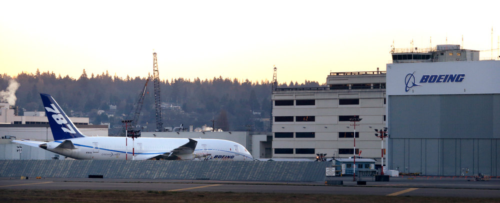 . A Boeing 787 sits parked at Boeing Field Wednesday, Jan. 16, 2013, in Seattle. Federal officials say they are temporarily grounding Boeing\'s 787 Dreamliners until the risk of possible battery fires is addressed. The Federal Aviation Administration said Wednesday it will issue an emergency safety order requiring U.S. airlines to temporarily cease operating the 787, Boeing\'s newest and most technologically advanced plane. (AP Photo/Elaine Thompson)