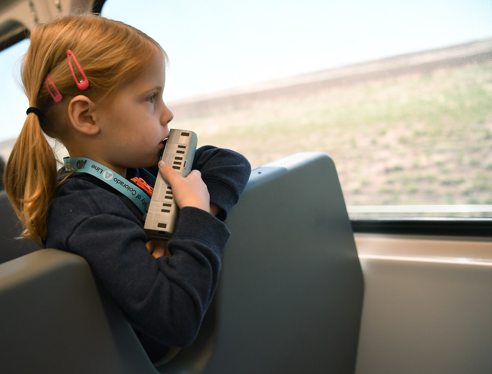 . Milly Conway, 3, rides the new University of Colorado A- Line from Denver International Airport to Union Station, April 22, 2016. The line is 23 miles with 8 stations along the way. (Photo by RJ Sangosti/The Denver Post)