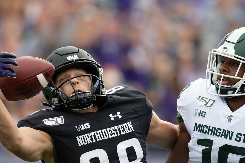 Northwestern University wide receiver Bennett Skowronek (88) attempts to catch the ball on a pass interference play during a game in Evanston, Ill. on Saturday, September 21, 2019. | Colin Boyle/Northwestern Athletics
