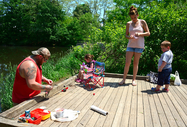5/29/2018 Mike Orazzi | Staff Joe Grecki and his son Case,3, and Angela Civitello and her daughter Ava,2, while fishing at Bristol's Birge Pond Tuesday afternoon.