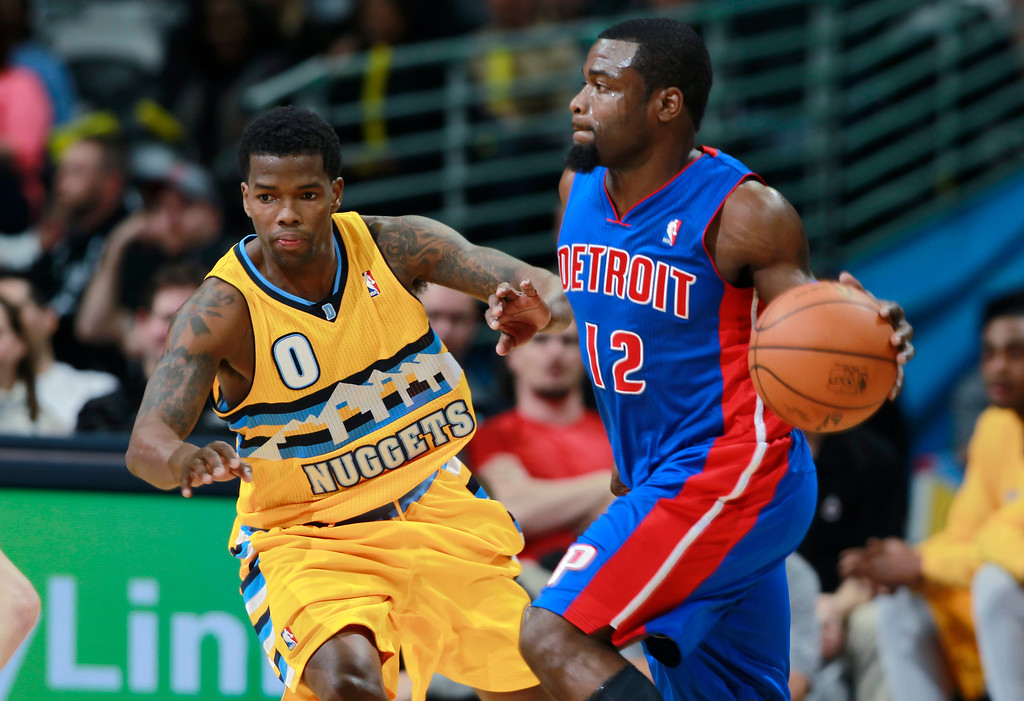 . Detroit Pistons guard Will Bynum, right, works ball inside as Denver Nuggets guard Aaron Brooks covers in the fourth quarter of the Nuggets\' 118-109 victory in an NBA basketball game in Denver on Wednesday, March 19, 2014. (AP Photo/David Zalubowski)