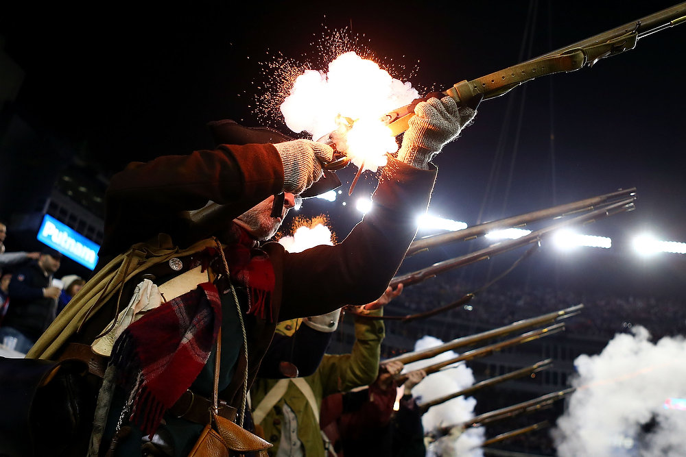 ". The ""End Zone Militia\"" of the New England Patriots fire their guns during the 2013 AFC Divisional Playoffs game at Gillette Stadium on January 13, 2013 in Foxboro, Massachusetts.  (Photo by Elsa/Getty Images)"