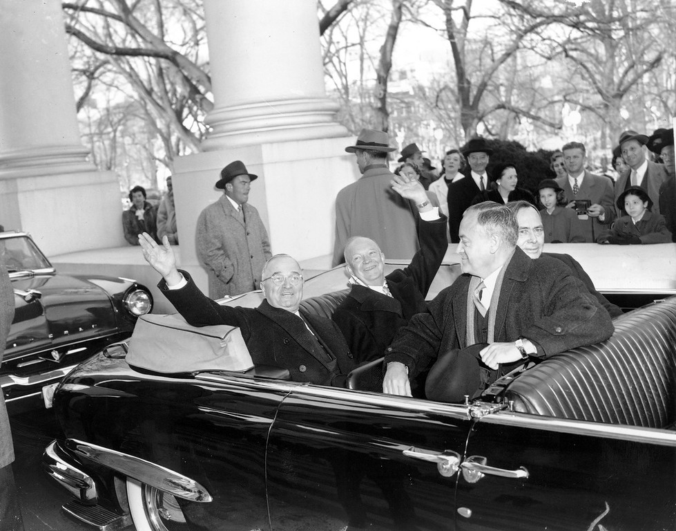 . With smiles and a wave, U.S. President Harry Truman, left, and his successor, president-elect Dwight D. Eisenhower, leave the White House in an open car for inauguration ceremonies in Washington, D.C. on Jan. 20, 1953. Sitting in the front is Sen. Styles Bridges of New Hampshire, and behind him is House Speaker Joe Martin. (AP Photo)