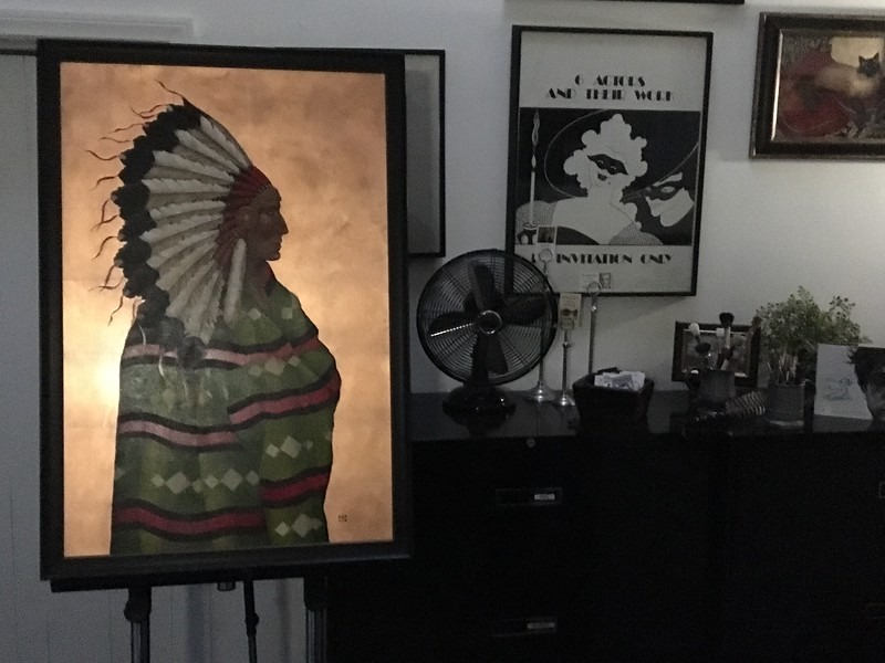 """YOUNG CHIEF / 39"""" x 29"""" Oil painting glowing with  Copper leaf in the matting and framing room!  $700"""