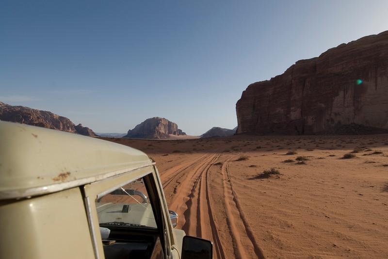 Jeep riding through desert in Wadi Rum, Jordan