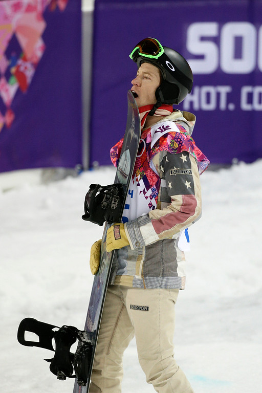 . Shaun White, of the United States, looks at the scoreboard after competing in the men\'s snowboard halfpipe final at the Rosa Khutor Extreme Park, at the 2014 Winter Olympics, Tuesday, Feb. 11, 2014, in Krasnaya Polyana, Russia. White placed fourth. (AP Photo/Jae C. Hong)