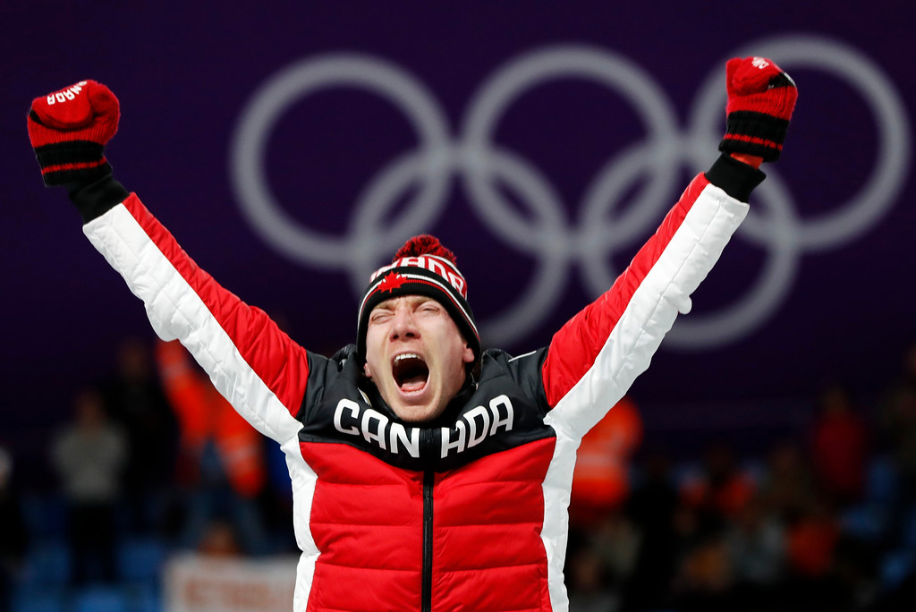 . Gold medallist Ted-Jan Bloemen of Canada celebrates on the podium after the men\'s 10,000 meters speedskating race at the Gangneung Oval at the 2018 Winter Olympics in Gangneung, South Korea, Thursday, Feb. 15, 2018. (AP Photo/Petr David Josek)