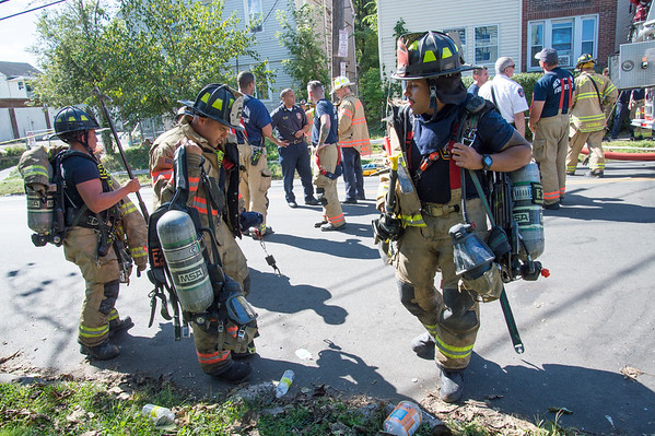 09/25/19 Wesley Bunnell | StaffrrA fire on the first floor of 24 Oak St was quickly knocked down by firefighters on Wednesday afternoon. Firefighters gather up their gear ready to leave the scene.
