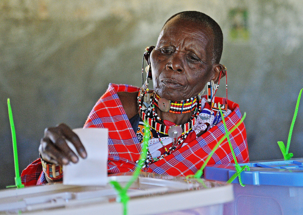 . An elederly Maasai woman is watched over by an IEBC official as she casts her vote in Ilngarooj, Kajiado County, Maasailand, on March 4, 2013 during the nationwide elections. Long lines of Kenyans queued from way before dawn to vote Monday in the first election since the violence-wracked polls five years ago, with a deadly police ambush hours before polling started marring the key ballot. The tense elections are seen as a crucial test for Kenya, with leaders vowing to avoid a repeat of the bloody 2007-8 post-poll violence in which over 1,100 people were killed and observers repeatedly warning of the risk of renewed conflict.    CARL DE SOUZA/AFP/Getty Images