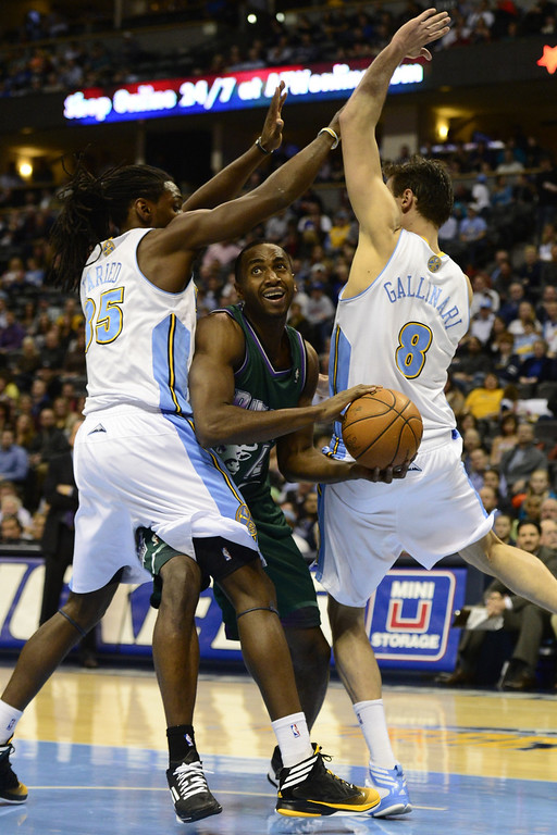 . DENVER, CO - FEBRUARY 5: Kenneth Faried Denver Nuggets (35) and teammate Danilo Gallinari (8) trap Luc Mbah A Moute Milwaukee Bucks (12) during the first half. The Denver Nuggets take on the Milwaukee Bucks in NBA action. (Photo By AAron Ontiveroz/The Denver Post)