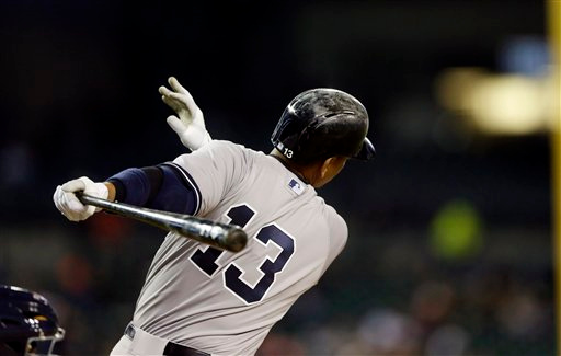 . New York Yankees designated hitter Alex Rodriguez bats during the sixth inning of a baseball game against the Detroit Tigers, Tuesday, April 21, 2015, in Detroit. (AP Photo/Carlos Osorio)