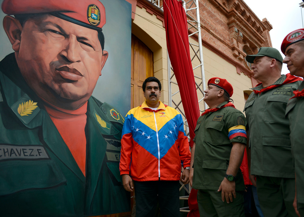 . (L to R) Venezuelan Vice President Nicolas Maduro, the president of the National Assembly, Diosdado Cabello and Venezuelan Minister of Defense Diego Molero Bellavia, stand next to a huge portrait of Venezuelan President Hugo Chavez during the conmemoration of the 1992 failed coup led by Chavez, who was an army lieutenant colonel, against then president Carlos Andres Perez, in Caracas, on February 4, 2013. Ailing President Hugo Chavez, who had cancer surgery in December, is doing much better and recovering, Cuban leader Fidel Castro said in remarks published Monday.  JUAN BARRETO/AFP/Getty Images