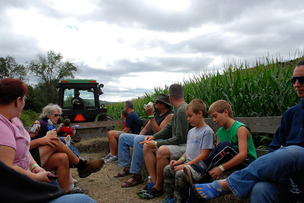 . Kayla Rice/Reformer Visitors take a hayride at Gaines Farm in Guilford.