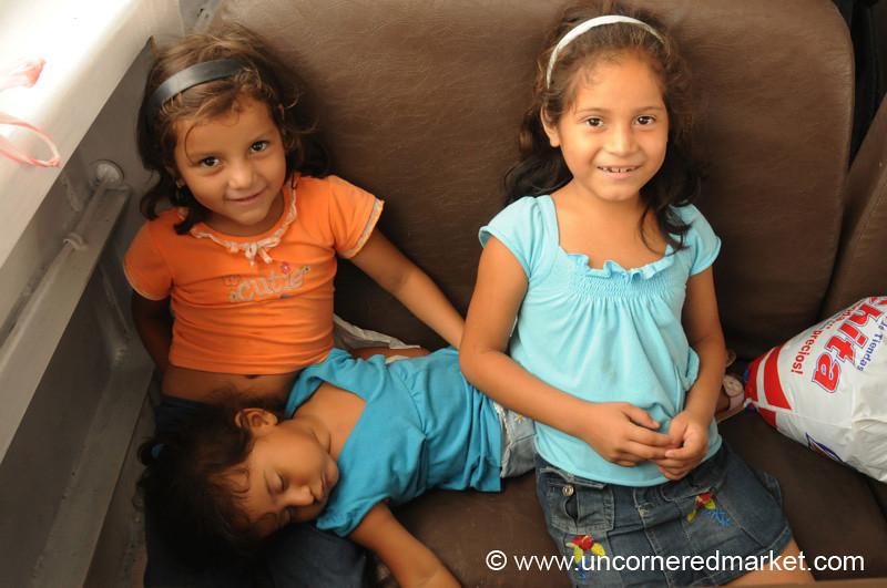 Little Girls on the Ferry - La Cebia, Honduras