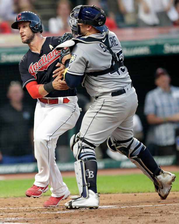 . Cleveland Indians\' Yan Gomes, left, is tagged out at home plate by Tampa Bay Rays catcher Jesus Sucre in the second inning of a baseball game, Saturday, Sept. 1, 2018, in Cleveland. (AP Photo/Tony Dejak)