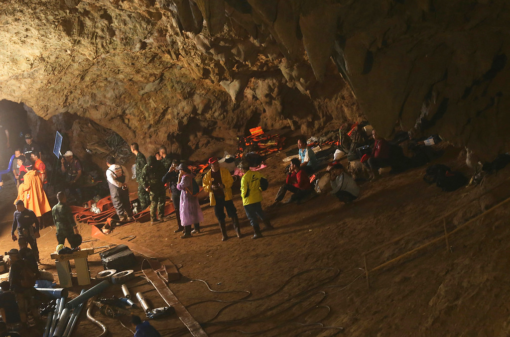 . Emergency rescue teams gather in the staging area as they continue the search for 12 young soccer team members and their coach after going missing in a large cave in Mae Sai, Chiang Rai province, in northern Thailand Wednesday, June 27, 2018. Rain is continuing to fall and water levels keep rising inside a cave in northern Thailand, frustrating the search for 12 boys and their soccer coach who have been missing since Saturday. (AP Photo/Sakchai Lalit)
