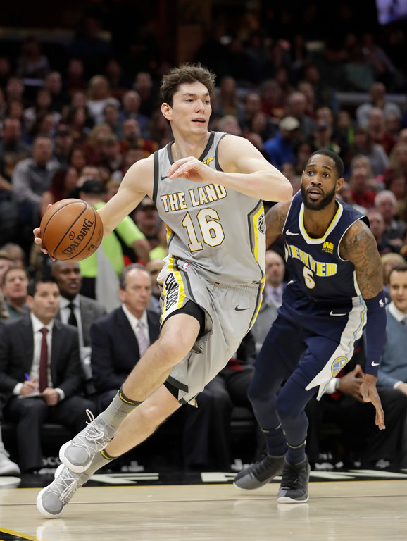 . Cleveland Cavaliers\' Cedi Osman (16), from Turkey, drives past Denver Nuggets\' Will Barton (5) in the first half of an NBA basketball game, Saturday, March 3, 2018, in Cleveland. (AP Photo/Tony Dejak)