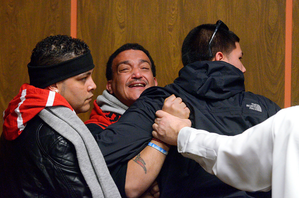 ". Father Jose Oliver of missing 5-year-old Jeremiah Oliver of Fitchburg stands by at left as Sandrino Oliver (2nd from left), is escorted out from Fitchburg District Court while yelling repeatedly, ""That\'s it? Where is my nephew?\"" following the competency hearing of Elsa Oliver, Friday. SENTINEL & ENTERPRISE / BRETT CRAWFORD"