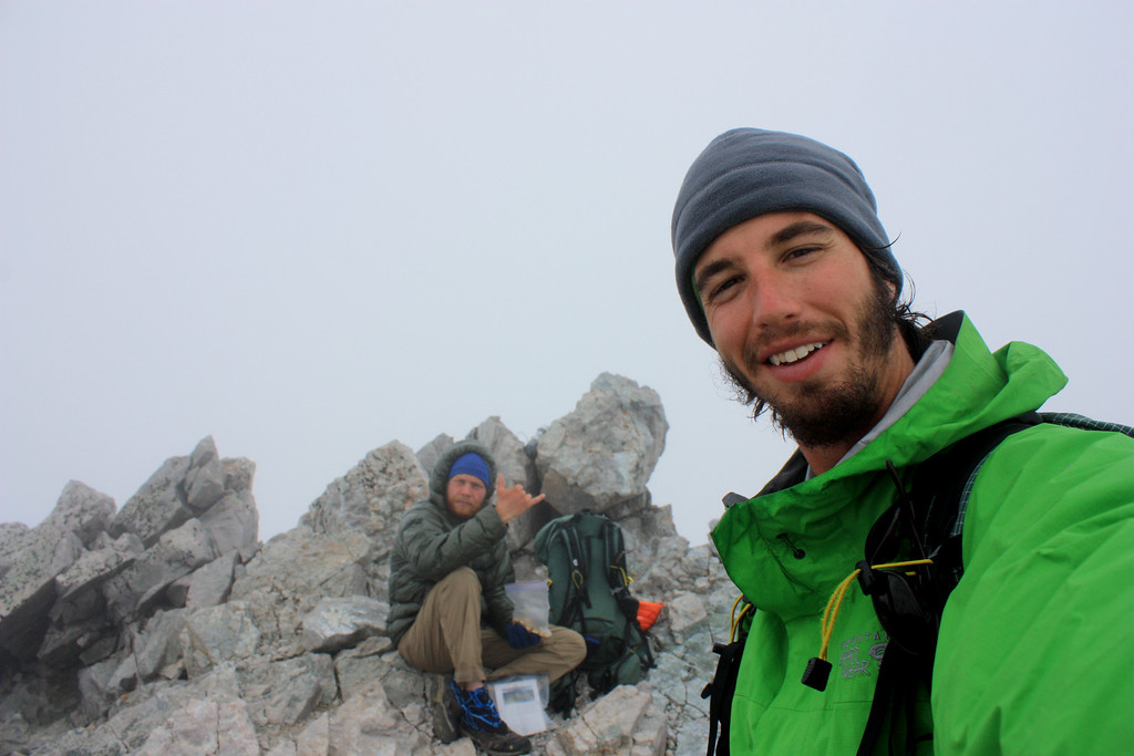 . Luke DeMuth, right, and Junaid Dawud celebrate atop Snowmass Mountain in August. The friends have hiked 1,300 miles and climbed 57 of the state\'s 58 14,000-foot peaks and plan to finish their 70-day mission Sunday on Longs Peak.