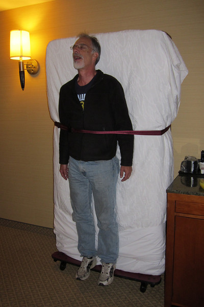 The hotel room was too small for crew to sleep horizontally, so Wayne made due.