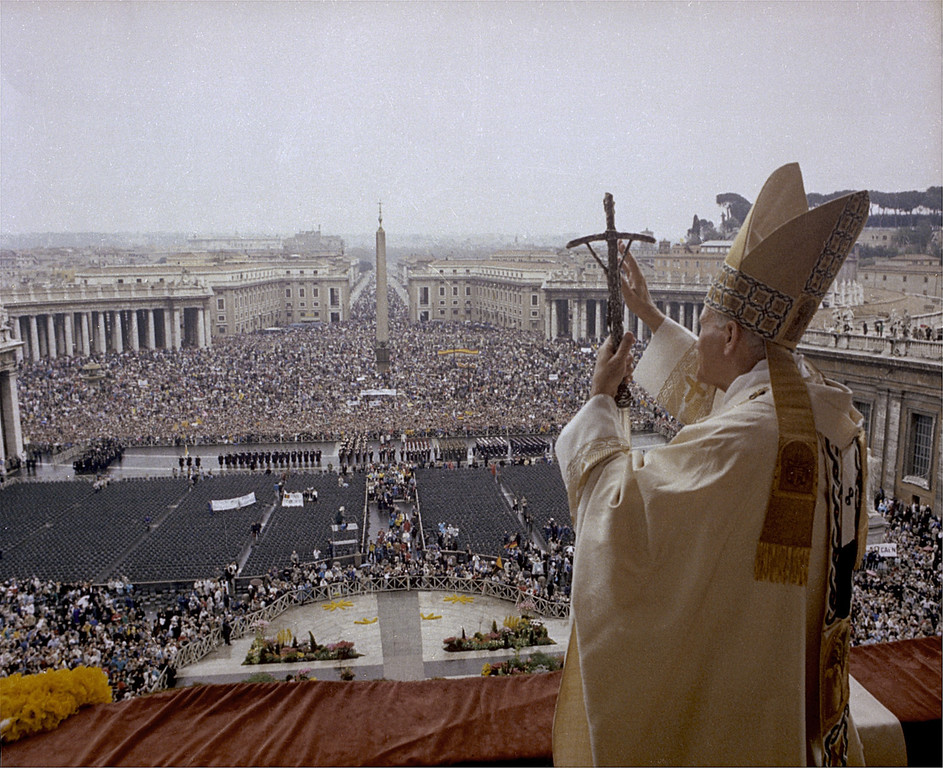 . Pope John Paul II gives the Easter blessing from the balcony of St. Peter\'s to the crowd gathered in St. Peter\'s Square on Easter, in this April 3, 1988 file photo. (AP Photo, File/HO)