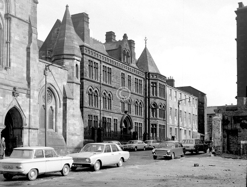 St Mungo's Church and retreat, and beyond it the building which formed the core of St Mungo's Academy from 1883 to 1973, though it expanded into several other buildings, including the Martyrs' School across the road.    March 1973
