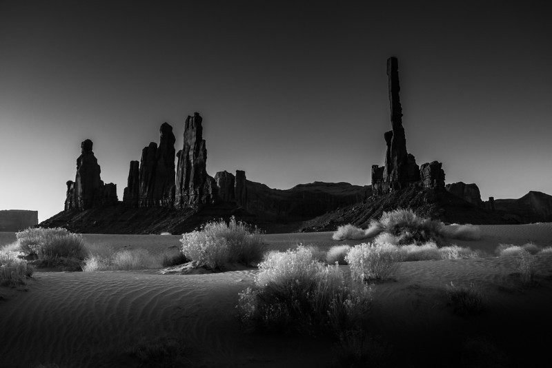 Black and white of the first sunrise in Monument Valley.