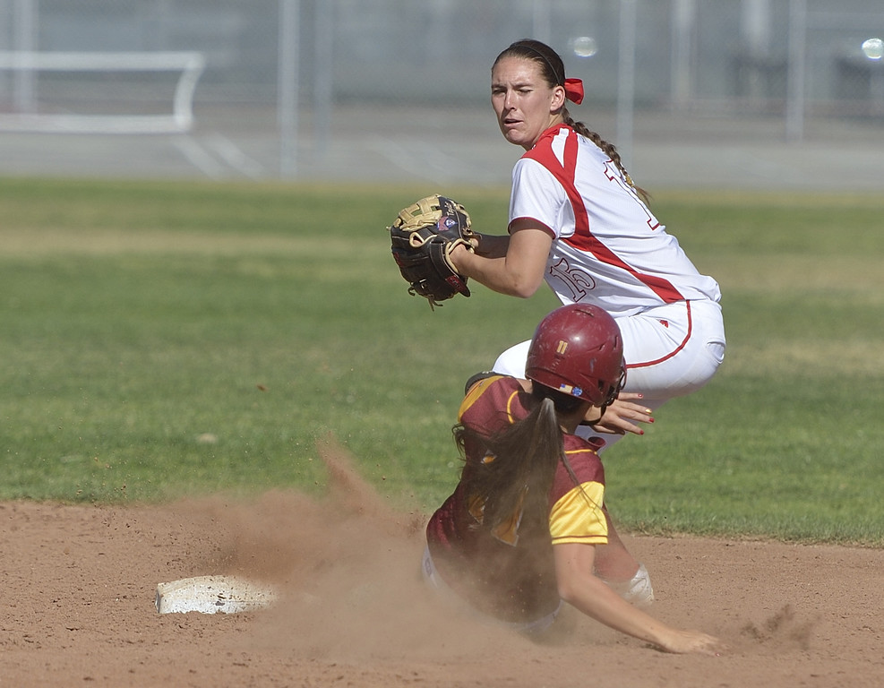 . LONG BEACH, CALIF. USA -- Wilson\'s Kori Cochran (11) is forced in to an out at second base with Lakewood\'s Taylor Manning (15) in Lakewood, Calif., on May 2, 2013. Lakewood defeated Wilson 11 to 1.  Photo by Jeff Gritchen / Los Angeles Newspaper Group