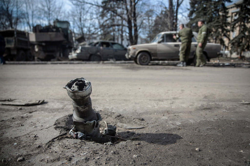 . DEBALTSEVE, UKRAINE - FEBRUARY 25:  A partially destroyed projectile sits lodged in the street on February 25, 2015 in Debaltseve, Ukraine. After approximately one month of fighting, Russian backed rebels successfully forced Ukrainian troops to withdraw from the town of 100,00 people on February 18. Only approximately 11,000 civilians remain in the town. Debaltseve is considered an asset to both Ukrainians and the rebels due to the railway station and it\'s connection to other eastern Ukranian towns.  (Photo by Andrew Burton/Getty Images)