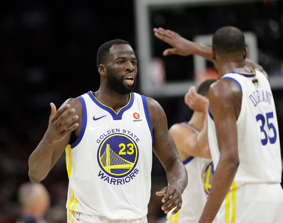 . Golden State Warriors\' Draymond Green and Kevin Durant celebrate during the second half of Game 4 of basketball\'s NBA Finals against the Golden State Warriors, Friday, June 8, 2018, in Cleveland. (AP Photo/Tony Dejak)