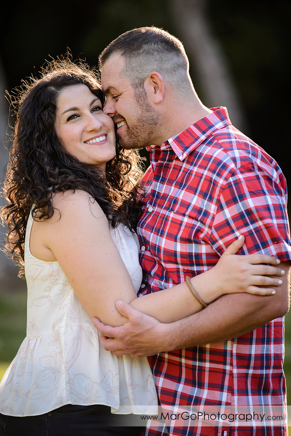 engaged couple kissing at Sanborn County Park