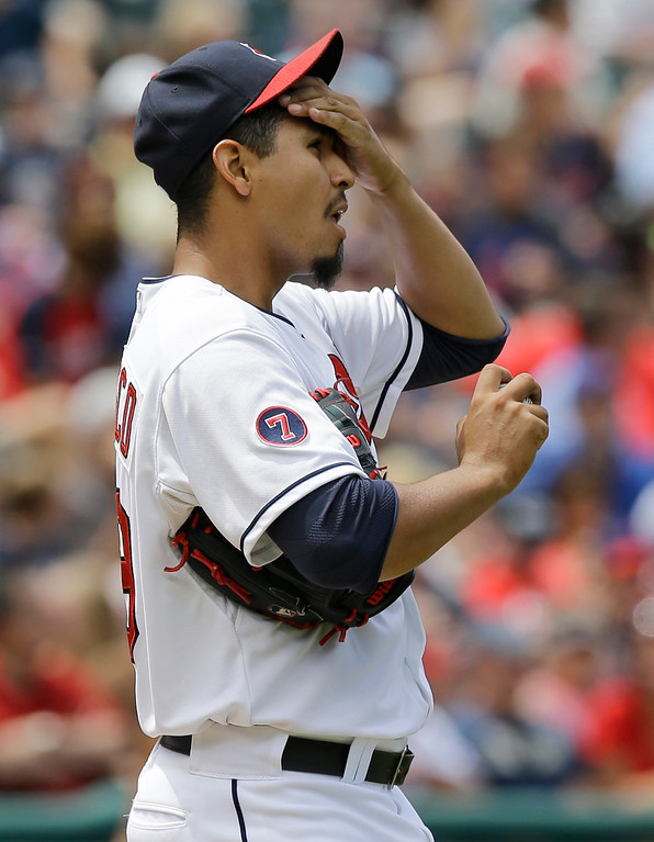 . Cleveland Indians starting pitcher Carlos Carrasco wipes is forehead after giving up a two-run home run to Detroit Tigers\' J.D. Martinez in the seventh inning of a baseball game, Wednesday, June 24, 2015, in Cleveland. (AP Photo/Tony Dejak)