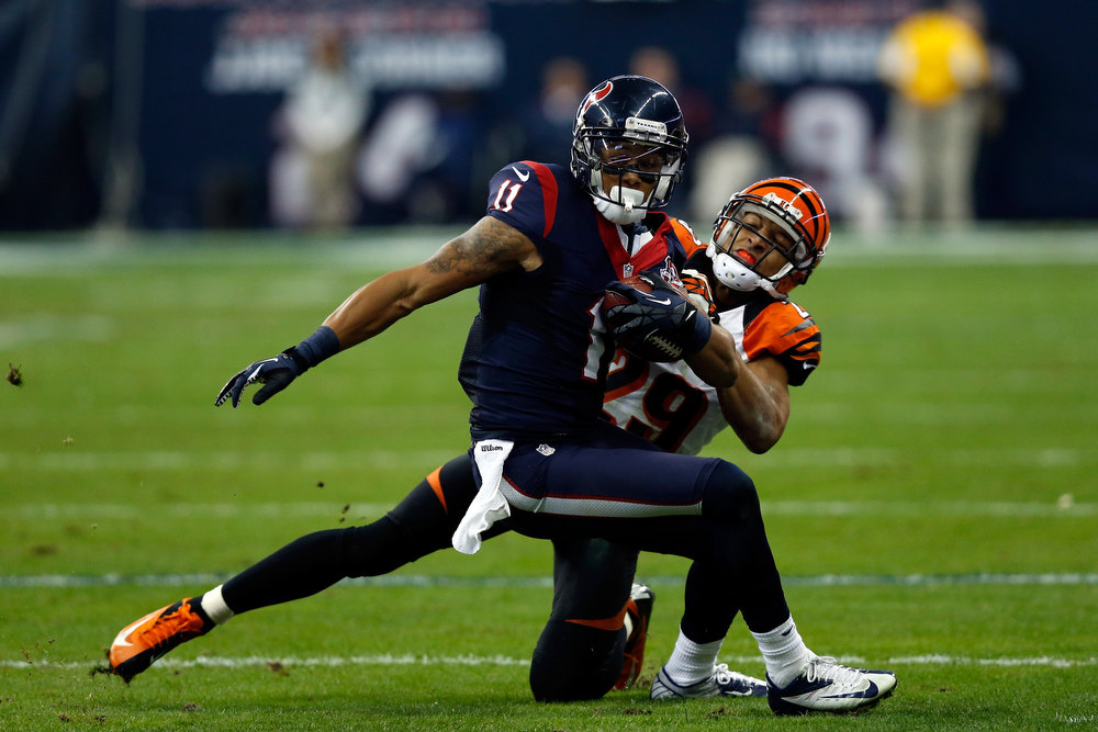 . DeVier Posey #11 of the Houston Texans makes a reception against Leon Hall #29 of the Cincinnati Bengals during their AFC Wild Card Playoff Game at Reliant Stadium on January 5, 2013 in Houston, Texas.  (Photo by Scott Halleran/Getty Images)