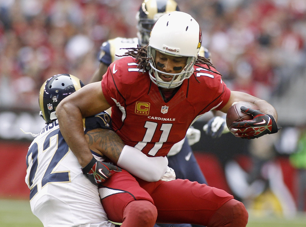 . Larry Fitzgerald #11 of the Arizona Cardinals is tackled by Trumaine Johnson #22 of the St Louis Rams after a first down reception during the second quarter of their NFL football game at University of Phoenix Stadium on December 8, 2013 in Glendale, Arizona.  (Photo by Ralph Freso/Getty Images)
