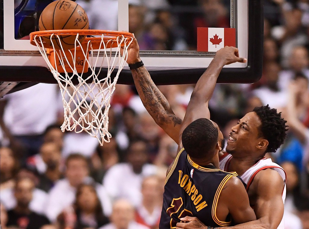 . Toronto Raptors guard DeMar DeRozan, right, is fouled by Cleveland Cavaliers center Tristan Thompson (13) on his way to the basket during the second half of Game 3 of an NBA basketball second-round playoff series in Toronto on Friday, May 5, 2017. (Frank Gunn/The Canadian Press via AP)