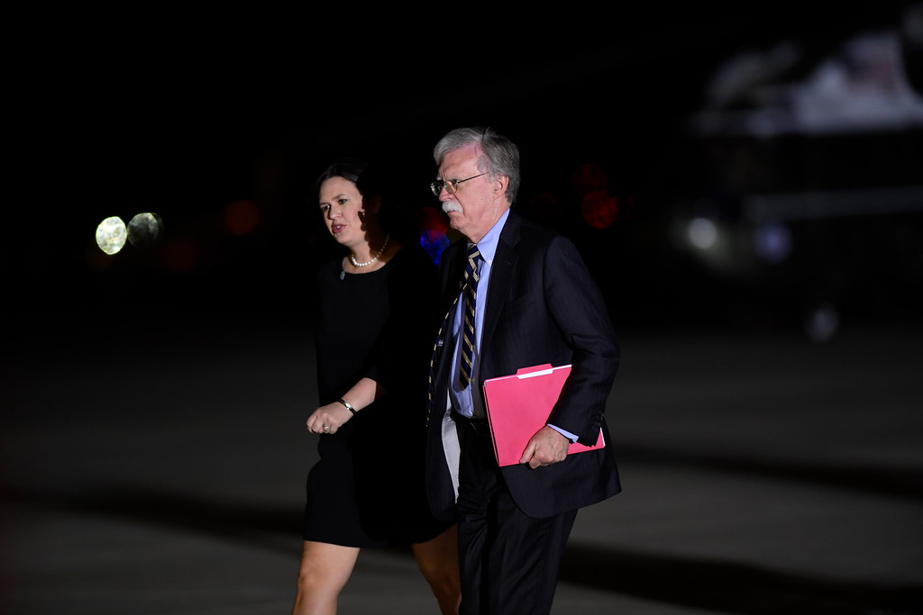 . White House press secretary Sarah Huckabee Sanders and national security adviser John Bolton arrive at Andrews Air Force Base in Md., to greet three Americans detained in North Korea for more than a year, upon their expected arrival at the base Thursday, May 10, 2018. (AP Photo/Susan Walsh)